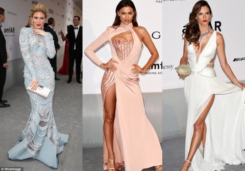 Glamour at 2014 AmfAR gala during Cannes Film Festival.