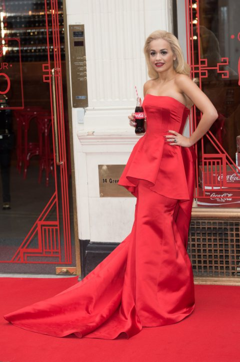 Rita Ora wears a red Veni Vici Dress at Coca-Cola Event in London.
