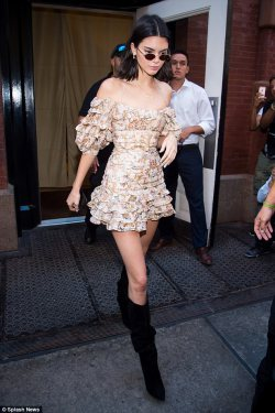 Kendall Jenner accentuates her tiny waist in ruffled mini dress